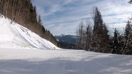 Track view of a skier going down the mountain