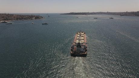 Tracking aerial shot of a cargo ship sailing