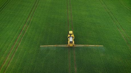 Tractor fertilizing the field