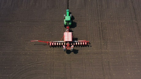 Tractor plowing an agricultural field