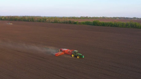 Tractor working and plowing the field