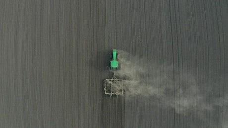 Tractor working in a dry field