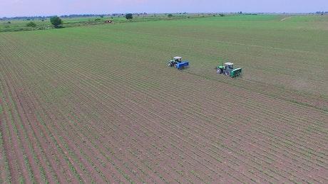 Tractors fertilizing agricultural fields