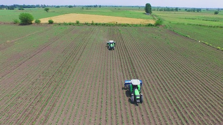 Tractors working on agricultural fields
