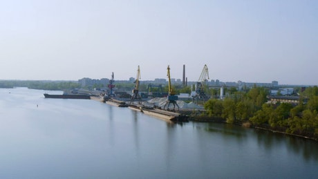 Trading port with cranes by the river