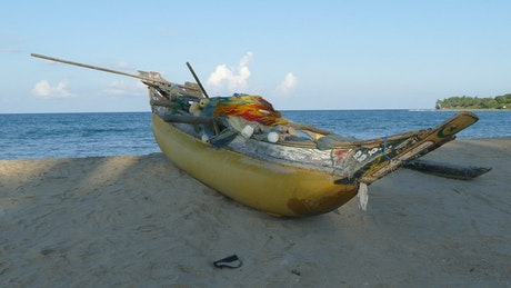 Traditional yellow fishing boat at the beach