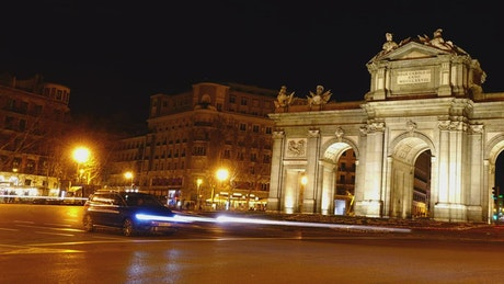Traffic at Puerta de Alcala at night