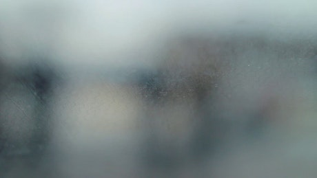 Traffic behind a rainy car window