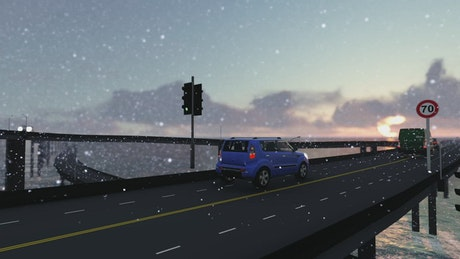 Traffic in a bridge over the sea while snowing