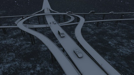 Traffic in the bridges over a river while snowing