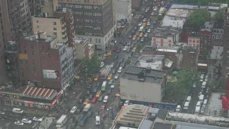 Traffic on Manhattan avenues, static upper view