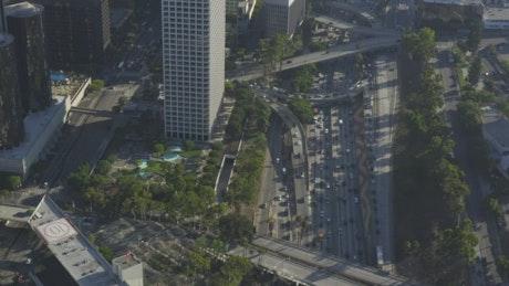Traffic under Los Angeles buildings, aerial shot