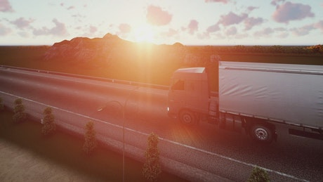 Trailer traveling on a road at sunset in 3D