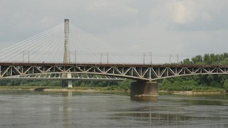 Train crossing a river bridge