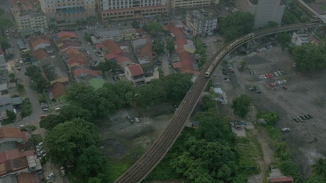 Train heading above a poor residential area