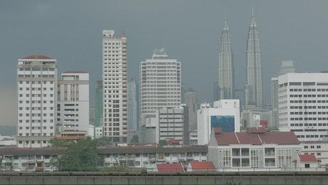 Train heading across the city in Kuala Lumpur