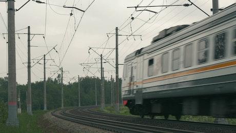 Train heading along a rural route