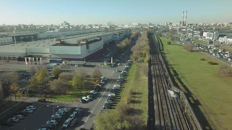 Train heading through an industrial city