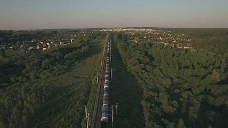 Train heading towards a rural town