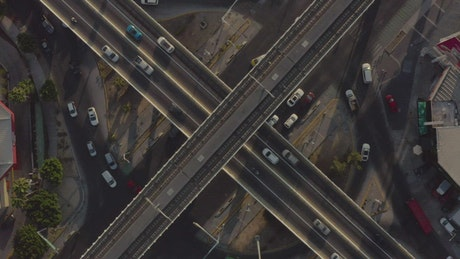 Train roads and cars of a city from above