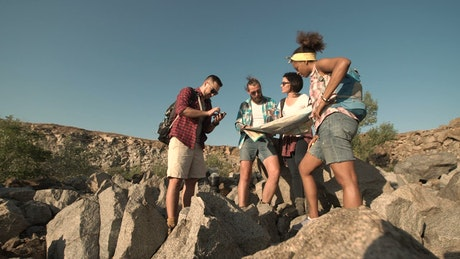 Travelers looking at map in the countryside