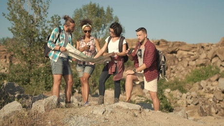 Travelers watching the map in the wild