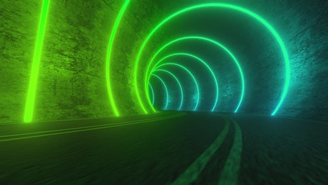 Traveling down a road in a tunnel lit by circles