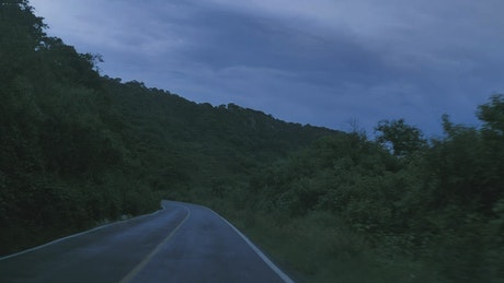Traveling on a nature road at dusk