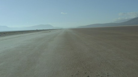 Traveling over a wide field in the desert of the highway