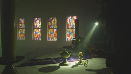 Treasure hunters looting a church