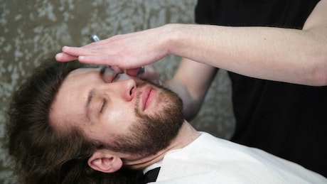 Trimming a beard with a razor