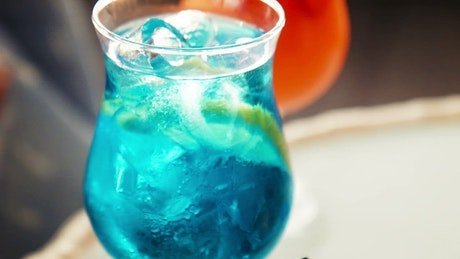 Tropical blue beverage with a fruit slice