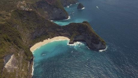 Tropical cliff with a calm sea