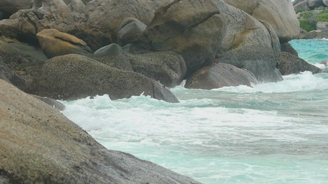 Tropical waves crashing on rocks