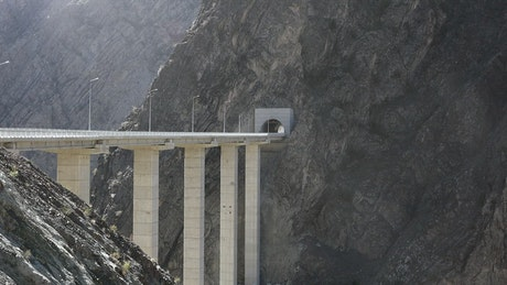 Truck crossing a concrete bridge in the mountain