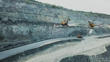 Truck driving down into a quarry