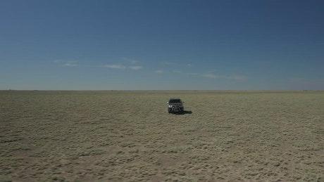 Truck heading through dusty terrain