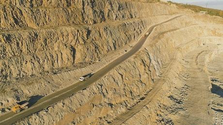 Trucks driving along a quarry road