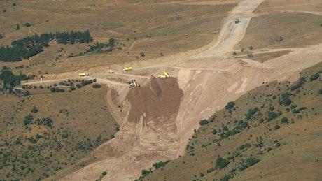 Trucks dumping dirt on a construction site