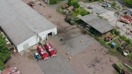 Trucks inside an industrial yard