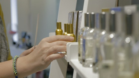 Trying perfume samples in a supermarket