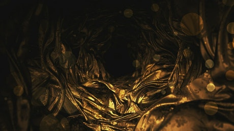 Tunnel of golden organic shapes rotating
