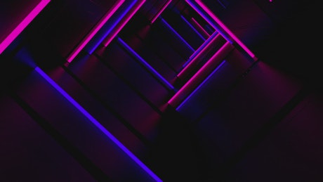 Tunnel with blue and pink neon light frames