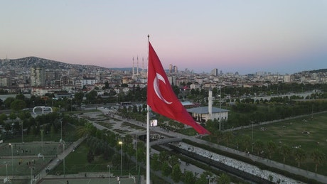 Turkey flag waving on top of a city