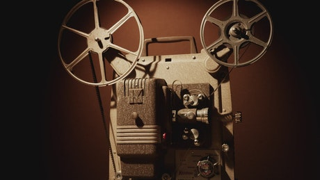 Turning on a vintage film projector