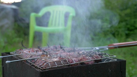 Turning over meats on the grill