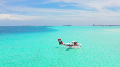 Turquoise sea with a plane floating