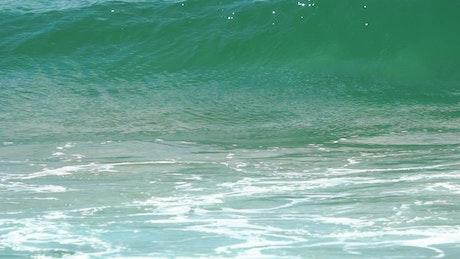 Turquoise wave crashes