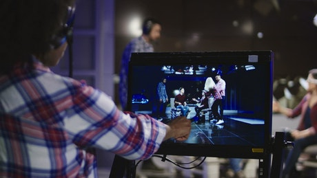 TV stage director watch it the recording the screen