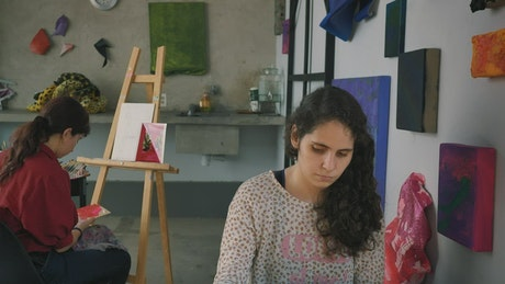 Two artist girls working in an artistic workshop